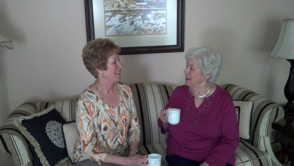 Pic of mother and daughter enjoying coffee